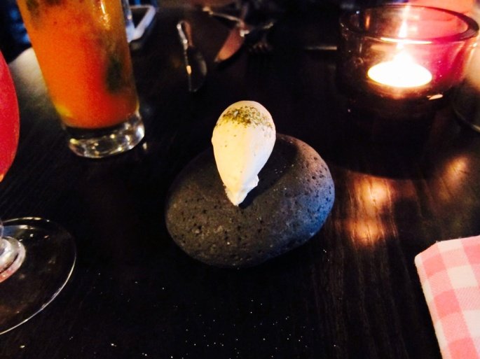 Butter for your bread served on a stone and sprinkled in lava salt.